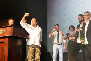 Ron Cooper salutes the crowd at Tales of The Cocktail Spirits Awards