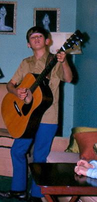 Young Jimmy playing his guitar.