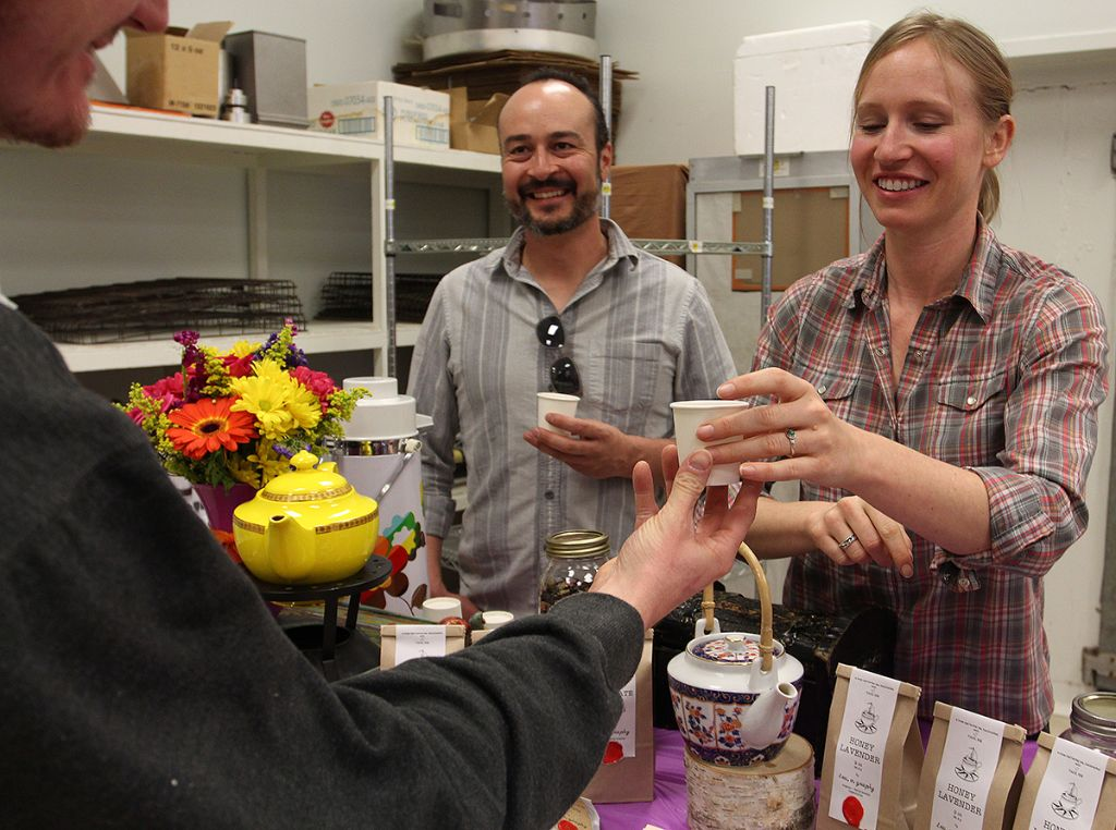 Dana Blair and her partner, Steve Chavez serving a sample of tea.o.graphy's Honey Lavender blend at TCEDC's Valentine Weekend event.