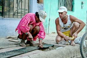 """""""Barefoot Ted,"""" and Miguel Luna making a pair of Huaraches for Ted in Mexico"""