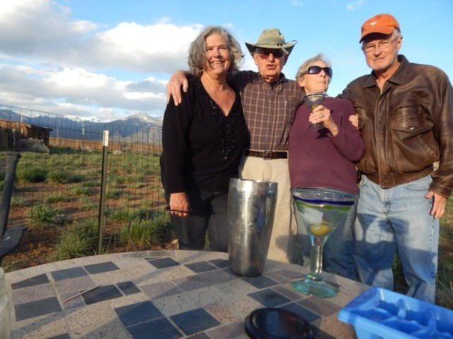 Claire at home on the Taos mesa, with friends and the author, Lewis (far right)